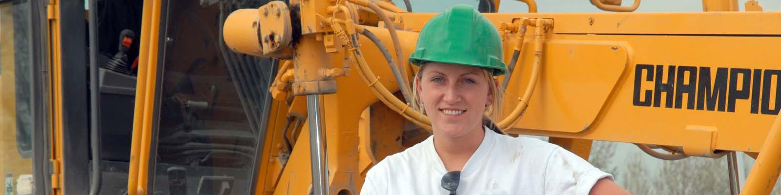Woman heavy equipment operator construction worker