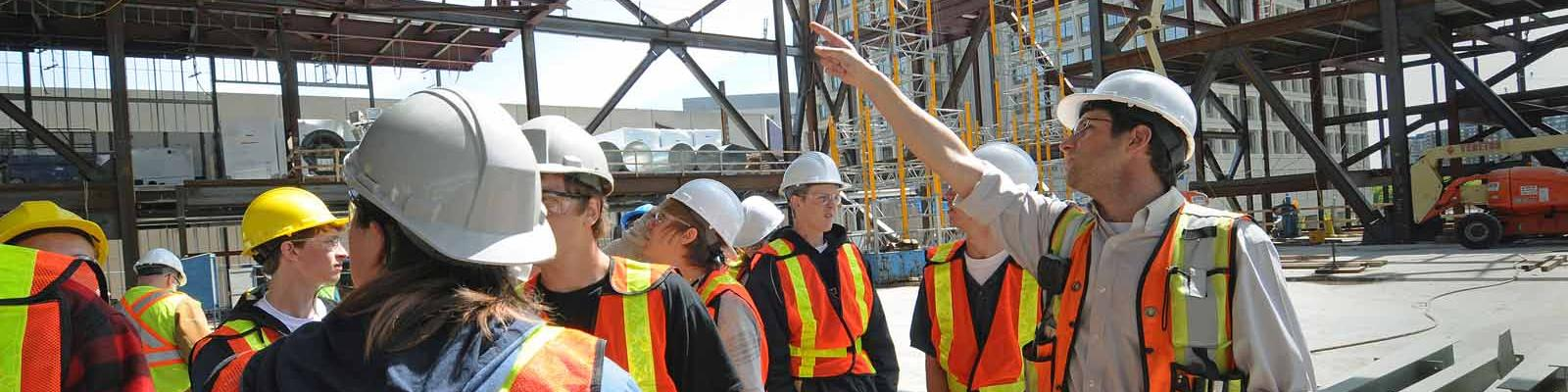 Students get a tour of a construction site