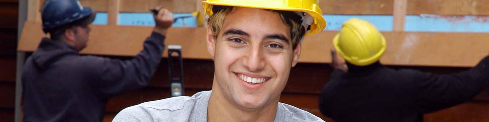 Male apprentice carpenter construction worker